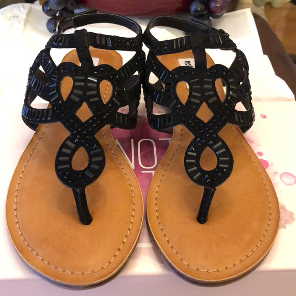 0ec250021025 Not Rated Seashell Black Sandals
